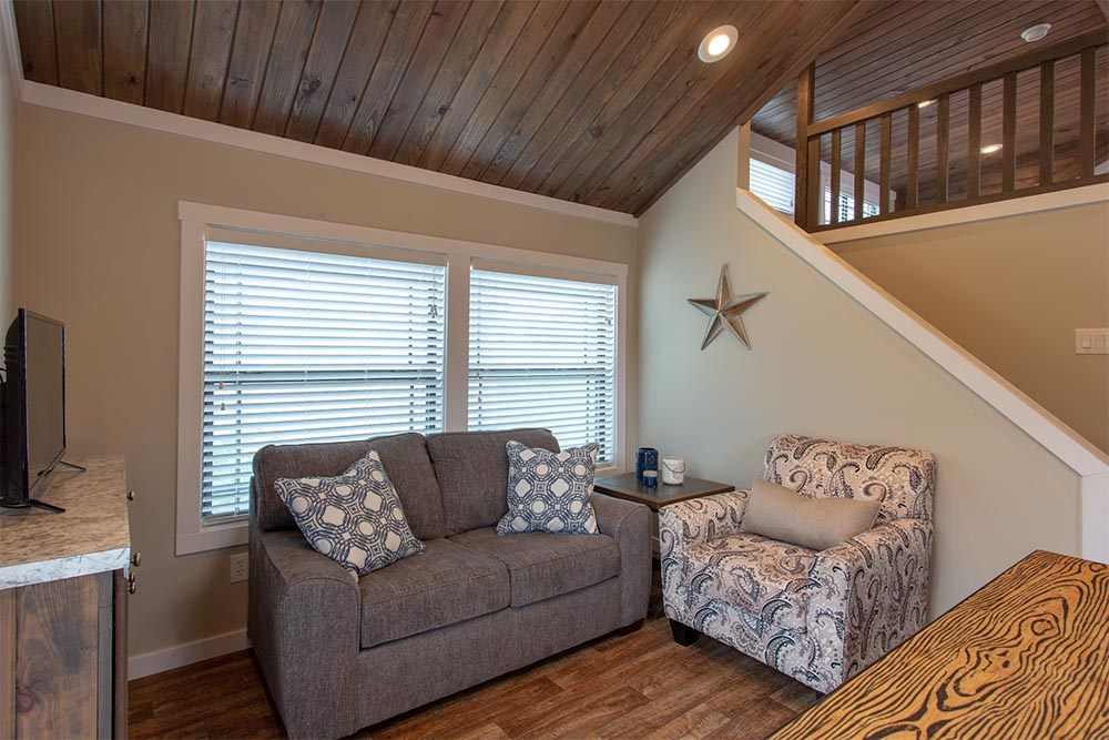 Couches in Living area of By The River Cabins
